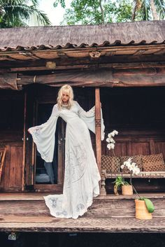 Anja Konstantinova wears Spell Designs The Gwendolyn Wrap Gown