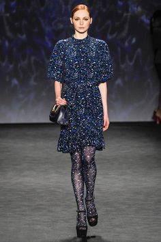 Vivienne Tam moves forward with the tights patterned as the dress trend here in a navy based print and easy to wear short dress.  Vivienne Tam Fall 2014 Ready-to-Wear Collection Slideshow on Style.com
