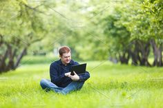 Man working with notebook park.. People Photos. $7.00