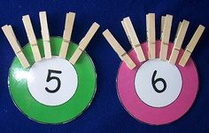 Attach same number of clothespins as written on card.