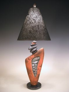 Rock On by Jan Jacque. A view of stones deep within the earth are revealed in the ceramic body of this lamp. Rich, earth-red color and pit firing add the special touch of the fire to this lamp. Bedside Table Lamps, Ceramic Table Lamps, Desk Lamp, Stone Lamp, Lampe Decoration, Paper Lampshade, Room Lamp, Bed Room, Unique Lamps