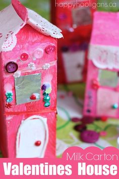 Milk Carton Valentines Houses - an easy Valentines craft for kids of all ages to make!  So gorgeous and fun to create!  They look lovely lining a tabletop or a window in a classroom!  - Happy Hooligans