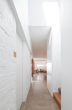 white brick walls and cement floor