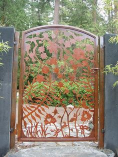Here's a custom iron gate that's plasma cut with an intricate design featuring forest ferns, vines and flowers.