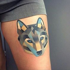 Geometric wolf tattoo blue and grey colour