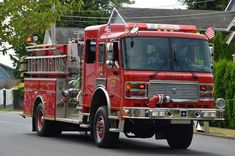 The rig is a 4x4 American LaFrance pumper with a top-mount pump and front intake.