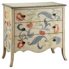 Hand-painted chest with a floral motif and scalloped apron.  Product: Chest    Construction Material: Engineered wood...