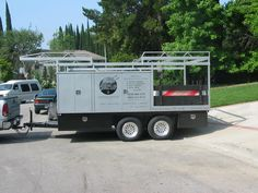 This heavily modified car carrier can haul tools, material, and anything else that will fit in or on its many storage spaces. Trailer Shelving, Trailer Storage, Truck Storage, Expedition Trailer, Overland Trailer, Cargo Trailers, Welding Trailer, Welding Trucks, Work Trailer