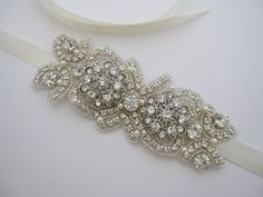 """This vintage inspired stunning swarovski pearl rhinestone headband is beautiful addition to your wedding day hair style on the side or in back with a veil, or in an updo. the rhinestone part measures approximately 5.5"""" X 2"""" .This headband is designed to wear side way (off center), and the lengt...    $75"""