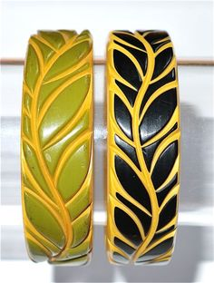 Carved bakelite bangles. Love!