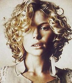 Short Simple Messy Curly Bob. I've had something similar but not quite this and it was cute.