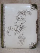 Victorian Celluloid Photo Album_31 photos & tin type_embossed cherub with wings and roses on cover_
