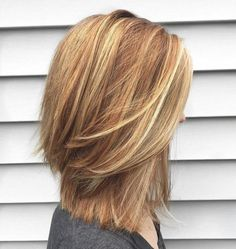 Layered Mid-Length Cut For Thick Hair