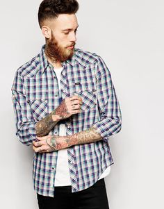 "Shirt by Lee Rider Breathable, woven fabric All-over print Point collar Button placket Twin chest pockets Curved hem Regular fit - true to size Machine wash 100% Cotton Our model wears a size Medium and is 6'3""/191 cm tall"