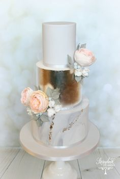 Marbled grey and silver leaf wedding cake with peach old english roses