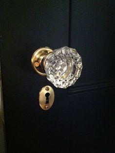 Black door, brass, glass knob