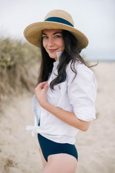 caa7c642293d6a Oxford cloth button down over navy bathing suit. Love the straw hat with  matching navy ribbon. [The College Prepster.
