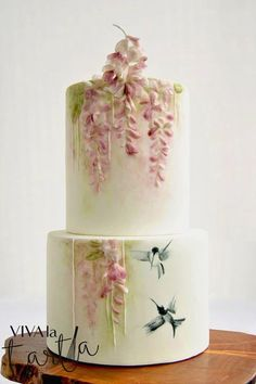 Image via We Heart It #baking #black #cakes #celebration #desserts #flowers #fondant #food #green #handpainted #hummingbird #layers #oriental #pink #round #spring #white #wisteria #basrelief #sumie #multi-tiered