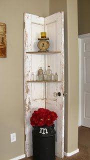 old door, cut in half- makes cute corner cabinet