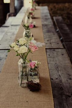 Very simply and easy table scape. Good idea for putting food in between flowers, buffet style, or on smaller picnic tables for people to sit at and eat.