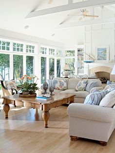 The windows are beautiful. Would love a family room that was this bright. Love the color of the couches.