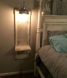 A shutter turned into a bedside space! Love it!