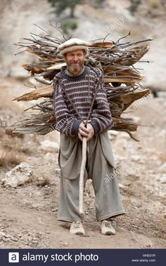 A Kalasha man carrying firewood, Kalasha valley, Chitral, North West Frontier Province, Pakistan