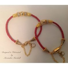 Saucy yet elegant red braided leather bangle bracelet with Swarovski crystal and Byzantine patterned 14kt gold overlay components. Discreet magnetic clasp with security chain and Swarovski tag. Medium and small sizes depicted here. Each $49.