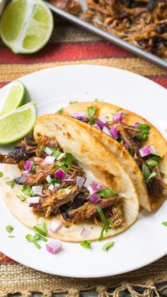 Amazing Carnitas: Today we're making it in the crock pot! This is easily the Best Slow Cooker Carnitas Recipe we've ever made, big on flavor and low on effort. #ASpicyPerspective #carnitas #tacos #pork #crockpot #slowcooker