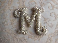 Pearl Monogram Letter 'M' by TheSnuggledStitch on Etsy, $19.50