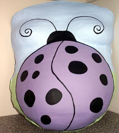 Cute lavender lady bug belly cast.