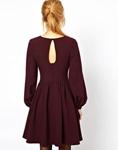 nicely shaped bordeaux dress.
