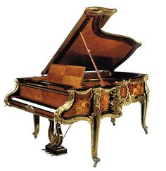 A Magnificent Steinway ormolu mounted grand piano in mahogany with satinwood, sycamore and fruitwood marquetry; serial #162322, circa 1913. It is valued between 300,000 to 500,000 dollars.