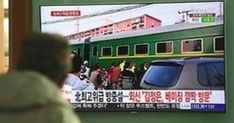A man watches a television news report about a suspected visit to China by North Korean leader Kim Jong Un, at a railway station in Seoul on March Jap. North Korea Kim, Mystery Train, Automobile, Korea News, Visit China, Korean Peninsula, Business Innovation, News Website, Trump