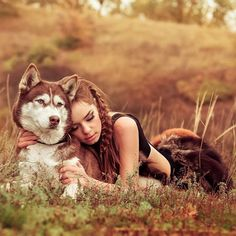 Photographer captures majestic image of a Siberian Husky and its owner.