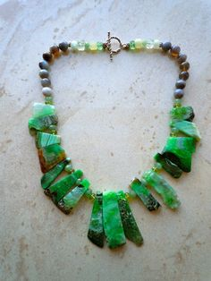 Now at the Rubin Museum of Art designed Gy Mirano: One-of- a-Kind Necklace, Brazilian Agate, Fluorite, Sterling.