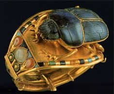 *EGYPT ~ Scarab bracelet excavated from the Tomb of King Tutankhamun. Gold with lapis lazuli,turquoise, carnelian and quartz.The small circumference of this bracelet suggests that it was made for Tutankhamun when he was a child. Art Antique, Antique Jewelry, Objets Antiques, Ancient Egyptian Jewelry, Egyptian Scarab, Egyptian Mythology, Scarab Bracelet, Egypt Art, Cairo Egypt