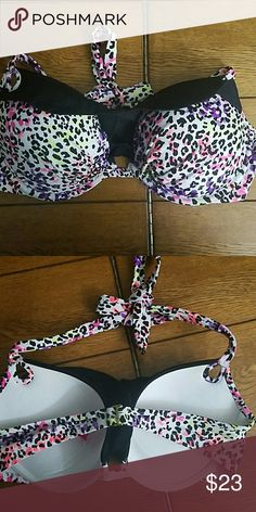 VS Bikini Top. EUC! Excellent used condition! Rainbow leopard print with black ruffle at the top. Padded (not removable). Underwire. Halter style. Ties around neck.  Open to offers.  Consider bundling. 30% off all bundle purchases!  Other VS bikini tops in my closet. Victoria's Secret Swim