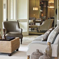 Style Guide: 90 Inviting Living Room Ideas | Try Natural Textures    Warm up a room with interesting textures. Woven accessories and ottoman keep things simple and natural. | SouthernLiving.com