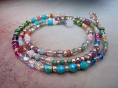 I loved making this bracelet, its strung so there is no cord covering the beautiful stones including pink opal, the pretty green garnet, turquoise blue, moonstone, quartz, sunstone, carnelian, swarovski, czech crystal, and all mixed with gold beads throughout..... its a 3 times wrap and filled with color and high quality gems!.. thanks for looking!  I use all authentic gems, peals, crystals in all my jewelry .. all made with natural products and I stand behind everything I make ** please…