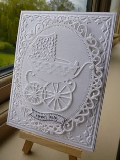 gorgeous baby card … all white … die cuts and embossing folder … lovely baby pram … - White Pram by sistersandie - Cards and Paper Crafts at Splitcoaststampers Baby Boy Cards Handmade, Baby Girl Cards, New Baby Cards, Greeting Cards Handmade, Pretty Cards, Cute Cards, Spellbinders Cards, Embossed Cards, Beautiful Handmade Cards