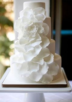 We did a variation of this for a 50th anniversary party.  Easy technique and looks absolutely lovely.    Google Image Result for http://www.nicoevents.com/event-planning/wp-content/uploads/2011/10/My-Sweet-and-Saucy-White.jpg