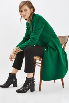 Make outerwear layers matter in this midi coat. In a long-line fit, it comes in a striking green with butted seams. Wear with heeled ankle boots for a fashionable finish. #Topshop