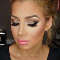 Love this bronze eye makeup and the hot pink lipstick to pop it all out !