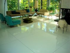 epoxy coated white concrete  White 1/2 inch thick polymer modified self level concrete, polished.