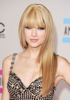 Taylor Swift's Beauty Transformation - 2010: At the American Music Awards Swift goes edgy with eye-sweeping bangs and a sultry smokey eye.