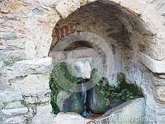 Marble ram's head scuplture on mountain spring on the outer wall of Kesariani Monastery, on the slopes of Mount Hymettus, Athens, Greece. The monastery was also known as the Ram's Head Monastery. It was built on the site of the ancient Temple of Dimitra, the goddess of agriculture.