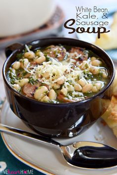 Easy White Bean, Kale, & Sausage Soup - A cozy, filling soup that's packed with nutrients and comes together in under 30 minutes! I used black beans bc I didn't have white, and added a can of tomatoes and half an onion. Soup Recipes, Crockpot Recipes, Cooking Recipes, Healthy Recipes, Sausage Crockpot, Chicken Sausage, Delicious Recipes, Bean And Sausage Soup, White Bean Kale Soup