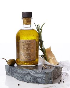 Extra-virgin olive oil made from Peranzana olives. Cold pressed in traditional granite mills. Infused with 18-kt. gold flakes. 8.5 ounces. Made in Italy.