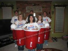 Beer Pong Group Costume: Beer pong! Ya, they sell them, but not nearly as awesome. We made this Beer Pong Group costume out of standard plastic garbage cans. We spray painted them